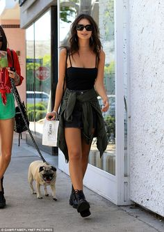 Taking a walk: The Gone Girl actress appeared relaxed as she strolled down the street with a friend and her dog