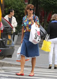 Post-fashion week:Helena Christensen, 48, opted for a more casual display as she stepped out in New York City on Friday, a week after her glittering return to the runway with the original 90s supermodels at the Versace Milan Fashion Week Show