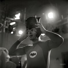 """Adam West on the set of the TV show """"Batman"""" in 1966. From a series of photos taken by Richard Hewett for Look magazine."""