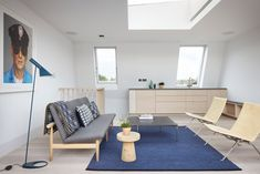 Chalcot Road by Studio Octopi. On the top floor, the architects introduced a skylit, snug living area with a kitchenette so the family's older children have a space of their own to escape to.
