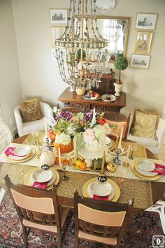 gold framed etchings and a traditional rug keep the dining room grounded and allows for fun elements - like a collection of pumpkins and fuchsia napkins 6th Street Design School: Feature Friday: Charming in Charlotte