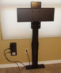 diy tv lift system to install behind the cabinet ---3rd choice for guest suite tv