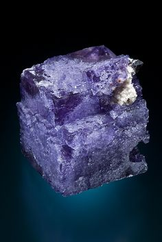 Elmwood Mine, Smith County, Tennessee USA Deep purple cubic floater crystal associated with small black sphalerite and dolomite. The crystal has clear gemmy zone on corners.