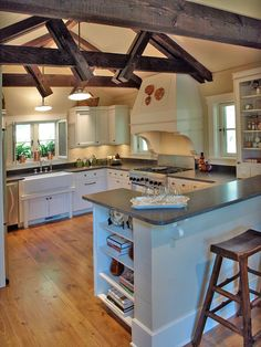 different cabinets and counters, but love layout and wood beams