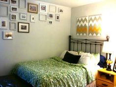 bedroom with photo display. hung high...i like that.