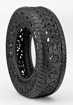 Beautiful patterns and designs carved into used car tires by Wim Delvoye.