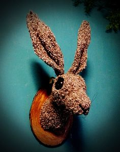 CRAFTED CREATURES FAUX TAXIDERMY HARE HEAD-MR HIGGIDY  The brown hare is larger than the European rabbit, has longer ears and hind legs and breeds on the ground rather than in a burrow. Usually nocturnal and shy, hares change their behaviour in the spring, when they can be seen in daylight chasing one another. During this spring frenzy, they can be seen 'boxing' each other with their paws. This is usually a female hitting a male, either to show she is not yet ready to mate or as a test of…