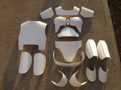 Female Mandalorian style Fan made armor.....this is a deluxe set that includes (1)Collar Piece, (2) Thermoformed/Vacuformed breast plates (Pronounced look), (2) Shoulders, (1)Stomach Piece, (1) Cod piece, (1)Back plate, (1) Butt plate, (2) Shin Guards, (2) Thigh Pieces, (2) Shoe tops, and Diamond piece...the Breast Plates are made one size fits most since they sit atop the breasts(PLEAE NOTE: BREAST PLATES MAY COME IN WHITE OR BLACK PLASTIC)....The last picture is the smaller breast plat...
