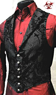 Black Tapestry Aristocrat Vest makes a grand statement of style for the bon vivant. Cut from a rich silver tapestry fabric on the front, our waistcoat features a black satin lining and back that ties with belting.