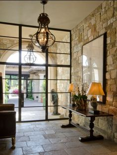 Stone entry and steel windows