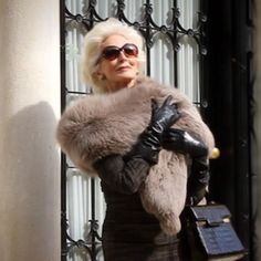 The one-and-only Carmen Dell'Orefice carrying a handbag by the one-and-only #Delvaux. Shop our capsule collection now. #ageless
