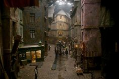 """They filmed part of Les Misérables at Pinewood Studios using a rebuilt version of the Diagon Alley set in Harry Potter. The crooked building is Gringotts Bank. I couldn't stop thinking about this during the movie - it just made it more epic! Les Miserables Movie, Film Story, Medieval World, Diagon Alley, Film Studio, Stage Set, Scenic Design, Set Design, Cinematography"