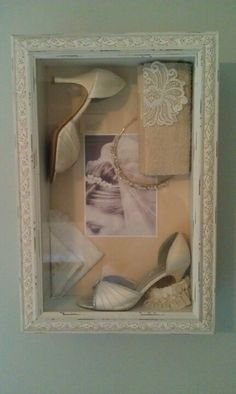 shadow box with wedding shoes, tiara, and wedding picture. I like this one to replicate with my keepsakes!