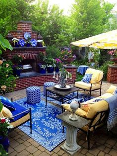 Wonderful 56 Cutie Pastel Patio Design Ideas : 56 Cutie Pastel Patio Design Ideas With Blue Yellow Sofa Table Pillow Chair Candle Flower Decor Umbrella And Fireplace And Natural Stone Floor And Flower Decor With Garden View