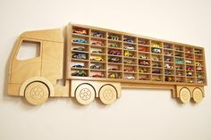 Toy Car 'Truck' Shelf, Model Car Shelving Unit, Lorry shaped Cubby Hole Storage Solution, Holds 60+ Cars. Timber Varnished Laquered Plywood by IconAndCoWales on Etsy https://www.etsy.com/listing/270248159/toy-car-truck-shelf-model-car-shelving