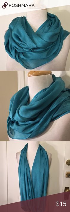 Look turquoise blue silk blend infinity scarf This is a beautiful light weight silk cotton blend infinity scarf from Look.  80% cotton 20% silk. Great condition. See pictures for details. Be sure to check out other items in closet and bundle to receive discounts. Look Accessories Scarves & Wraps