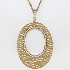 Unique14k Yellow gold oval shape hammered pendant, bead set with diamonds hung on a double chain.