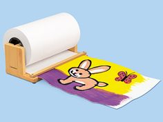 """Whether you need a little paper or a lot, Lakeshore's Super-Safe Tabletop Paper Center puts the perfect amount at your fingertips! Our hardwood center has a safe """"cutting"""" edge, plus a lift-out dowel that makes replacing the rolls a snap!"""