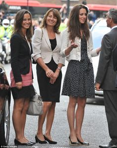 Catherine Middleton (right) is seen arriving with her mother Carole Middleton (middle) and sister Pippa Middleton (left) at the Goring Hotel, where she spent her last night as a single woman ahead of the Royal Wedding on April 28, 2011