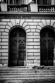 Can you see the contradiction - In front of the Secretary of Justice, a   homeless sleeping.  Sao Paulo, Argentina