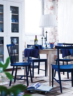 [I want a blue kitchen with warm, sunny yellow accents. These chairs look like they'd be perfect!]
