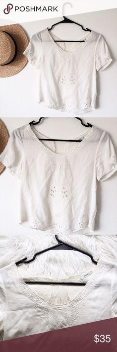 UO Dainty Lace Top Super cute dainty white top from Urban Outfitters (Kimchi Blue). Size XS, worn twice but good condition! Lace detailing on the back. Urban Outfitters Tops Blouses