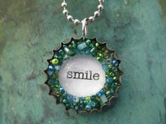 DIY Bottle Cap Necklace | maybe with something different in the middle though.