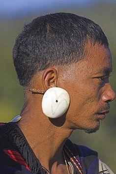 Naga man wearing conch shell ear ornament, Naga New Year Festival, Lahe village, Sagaing Division, MYANMAR (BURMA)