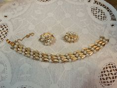 Lovely bracelet and earring set by Trifari! Links have both Shiny and Satin gold finishes and faux pearls, Very classic style can be dressed up or…