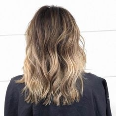 Natural looking dye jobs are our favorite! Dark brown lob with a slow fade to caramel blonde will give you a few month break from your favorite hair salon. The style is perfect for all salon slackers out there.