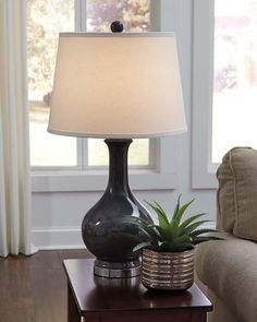 L100454 in by Ashley Furniture in Kirksville, MO - Ceramic Table Lamp (1/CN)