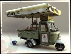 wurstel. Three wheeled food cart. How much an awning/umbrella does!                                                                                                                                                                                 Mais