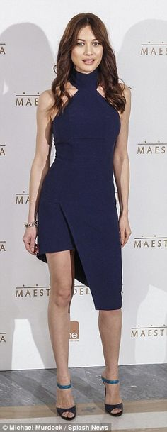 35 Stunning: Olga was stunning in a navy figure hugging asymmetrical dress that showed off her toned legs while Russell went for an all black suit with a grey coat over the top