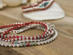 A stunning Womens Stackable Silver Beaded Wrap Evil Eye Bracelet  Bohemian chic is not only a look, but also an inner feeling. This beaded bracelet will give you both the comfortable,casual vibe and with an effortless boho chic look.  This Boho wrap bracelet will upgrade any look on any occasion. You can wear it as two layered bracelet or as a short necklace, and by adding some more bracelets from my collection your presence will become more impressive and strong.  Combining Sterling Silver…