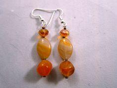 Orange glass and crystal beads.