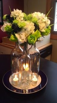 Clear glass wine bottles - DIY centerpiece I already have the wine glasses and candles, just need the flowers! Wine Bottle Centerpieces, Diy Centerpieces, Centerpiece Wedding, Bottle Candles, Bottle Vase, Wine Bottle Crafts, Wine Bottles, Glass Bottles, Wine Craft