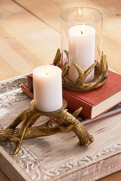 Crafted to resemble a pair of intertwining antlers, Pier 1's exclusive rustic pillar stands make a strong base for your favorite candles. Fitted with an iron pillar plate, they're finished with a resinous golden glaze for a touch of glam.