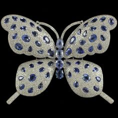 Blue Sapphire Butterfly Brooch with 59.68 carats of blue sapphire and 18.35 carats of diamonds.