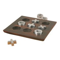Wood and metal tic-tac-toe set.Product: 9 Piece tic-tac-toe gameConstruction Material: Metal and woodColor...
