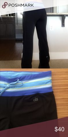 Alo Yoga cool fit tie waistband workout pant! Perfect for jaunts around town or sun salutations! These pretty pants feature a flattering wide waistband with tie. Fitted through the leg then flares at bottom. The backs of the legs have slits for maximum movement. Logo at back leg as shown. 88% nylon, 12% spandex. Perfect condition, worn once if at all. Downsizing my closet and I have too many yoga pants! ALO Yoga Pants