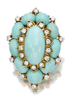 A turquoise and diamond brooch, Van Cleef & Arpels designed as a oval turquoise cabochon cluster, enhanced by circular-cut diamonds; signed Van Cleef & Arpels, NY, no. 38052; estimated total diamond weight: 3.45 carats; mounted in eighteen karat gold; length: 2 1/4in.