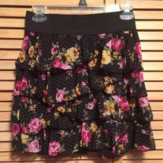 Floral Skirt Black skirt with pink & yellow floral print. Black band around top. Size small. Skirts