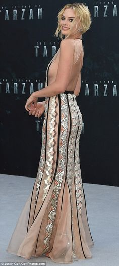 Dressed in deco: The 26-year-old blonde beauty looked like she was flashing a serious amount of flesh as she arrived on the red carpet but the illusion was down to the clever nude, art-deco inspired gown she was sporting on the night