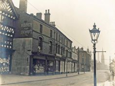 1910 Whitakers on left. Rest of row demolished and replaced by Aspinall Building containing Aspin Hall which was also built further back