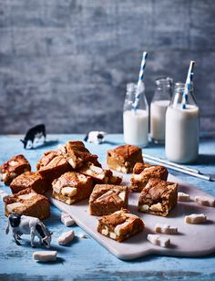 White choc chunks, a drizzle of condensed milk and a topping of chewy milk bottle sweets give these blondies a wonderfully creamy, milky flavour.