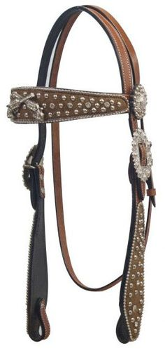 Hair on cowhide headstall with crossed guns concho on browband.- Hair on cowhide headstall with crossed guns concho on browband.