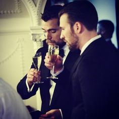 oh, it's nothing, just Superman and Captain America sharing a drink... in tuxes