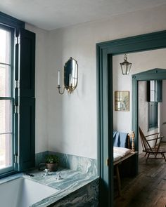 Hallway and Medium Hardwood Floor The couple's preference for raw, natural materials, tactile surfaces, and verdant color can be seen throughout the house. Photo 7 of 13 in An Architect Couple Give This Townhouse a Sumptuous Refresh bathroom Modern Bathroom Design, Bathroom Interior, Bathroom Designs, Modern Interior, Interior And Exterior, Interior Shutters, Window Shutters, Interior Walls, Modern Townhouse