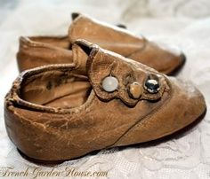 Little brown shoes with mismatched buttons!