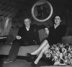 Pablo and Dora sitting in front of one of her paintings, 1940s
